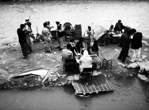 Call centre people at work in the middle of the dirty Kabul river